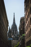 Cathedral between two buildings. In Barcelona Stock Photo