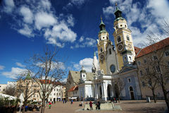 Cathedral with two towers. Ancient square in small alpine town Bressanone (Brixon) on a sunny day. Cathedral with two towers Stock Image