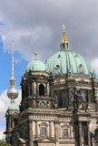 Cathedral and tyhe TV Tower in background  in Berlin Germany. Huge Dome of the Cathedral and tyhe TV Tower in background  in Berlin Germany Royalty Free Stock Photography
