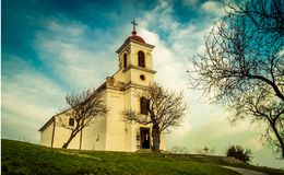 Cathedral Under Clouds Near Leafless Tree Royalty Free Stock Photos