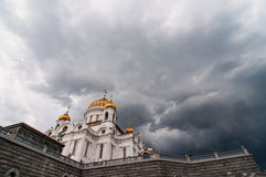 Cathedral under the dark cloud Stock Photos