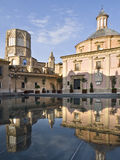 Cathedral of Valencia. Rear view of the Cathedral of Valencia (Spain) reflected on a water fountain in the historic city Stock Photos