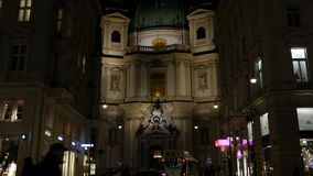 Cathedral in Vienna. Christian Cathedral in Vienna taken by night with many lights and traffic in front of it stock video