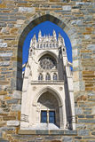 Cathedral(Washington National). National cathedral in Washington DC through an arch on a stone wall stock photos