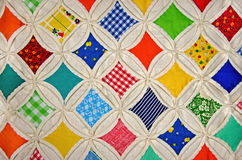 Cathedral Window quilt pattern. Close up of a Cathedral Window quilt Stock Photos