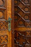 Cathedral wooden carved door close-up Stock Photos