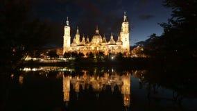 Cathedral in Zaragoza from Ebro river in   night stock video
