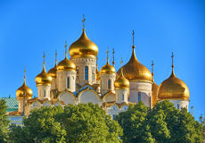 Cathedrals in the Kremlin. With patches of sunlight on the domes Royalty Free Stock Image
