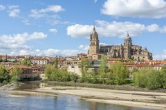Cathedrals of Salamanca Spain. Cathedrals of Salamanca seen from the bank of the river Tormes in spring Royalty Free Stock Photo