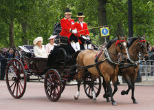 Catherine and Camilla seat on the Royal Coach Stock Photos