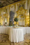 The Catherine Palace - Cavaliers Dining Hall - Courtiers-in-Attendance Dining Room. Catherine Palace is a Rococo palace located in the town of Tsarskoye Selo Stock Photo