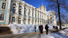 Catherine Palace and the palace church in Pushkin. Catherine Palace and the domes of the palace church, people walking around, taking pictures, in winter in stock video footage