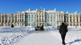 Catherine Palace and people  in Pushkin city. Catherine Palace and people, walking around on a sunny weather in winter, in Pushkin (Tsarskoye selo), the environ stock footage