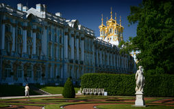 Catherine Palace, Tsarkoe Selo, St. Petersburg, Russia. The pale blue, white plaster, and shimmering gold domes of the Catherine Palace in St. Petersburg, Russia Royalty Free Stock Photos