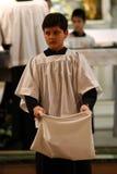 Catholic Altar Boy. Peforming religious duties Royalty Free Stock Images