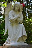 Catholic angel statue kneeling and praying. Royalty Free Stock Photo