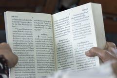 Catholic Bible Language Thai. People Reading Catholic Bible Language Thai Royalty Free Stock Photography