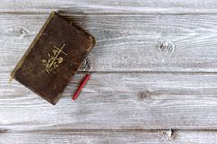 Catholic bible and red church nonflammable candle on wooden background with copy space stock photography