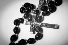 Catholic black wooden beads with metal crucifix Stock Photo