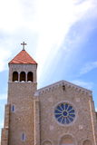 Catholic Cathedral. A modern Catholic cathedral with clouds and blue sky Stock Image