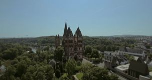 Catholic Cathedral of Limburg. The Catholic Cathedral of Limburg is high location on a rock above the Lahn river, Limburg, Germany, Jun 2017 stock video footage