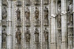 12 statues on the cathedral in Seville. The Catholic Cathedral in Seville Spain. Fragment with twelve statues. Stone sculptures of men and women on the ledges Stock Images
