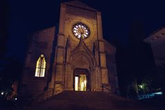 Catholic Christian church at night. Gothic architecture. Yalta, Crimea. Catholic Christian church at night. Gothic architecture. Yalta, Crimea Stock Photo