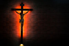 Catholic Christian Crucifix in silhouette flushed left. Royalty Free Stock Images