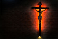 Catholic Christian Crucifix in silhouette flushed right. Royalty Free Stock Image