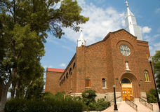 Catholic Church. Old catholic church with two crosses and a saint Royalty Free Stock Photography