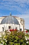 Catholic Church. Flowers on the Background of the Catholic Church in the French city of Ales Royalty Free Stock Image