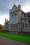 Catholic church. Grey stone catholic church on a green grass Stock Image