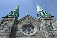 Catholic church. Old Catholic church reaching the blue sky royalty free stock photo