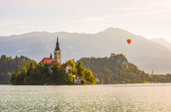 Catholic Church in Bled Lake and Bled Castle, Slovenia with Hot Royalty Free Stock Photography