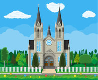 Catholic church cathedral with trees and fence Royalty Free Stock Photography