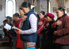 Catholic Church in chinese country. Catholics in the  Church in  southwest china's Yunnan  province, this  church  was built in  1910's by French missionaries Stock Photo