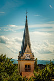Catholic church clock tower  among tree crowns Stock Photography