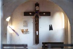 Catholic church cross detail indoors Stock Image