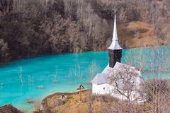 Catholic church and drowned cemetery. Waste lake with cyanide po. Catholic church and flooded cemetery next to drowned village at Geamana lake near gold mine of Stock Photography