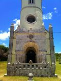 Catholic church entrance with bell tower Royalty Free Stock Images