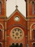 Catholic church facade with clock and two towers royalty free stock photo