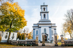 Catholic church. In fall with yellow leaves and blue sky. Lithuania city of Nemencine Stock Images