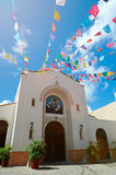 Catholic church with flags Royalty Free Stock Photography