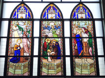 Catholic church four stained glass long windows Royalty Free Stock Photos