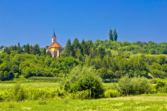 Catholic church on idyllic green hill Stock Photography
