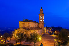 Catholic church illuminated at night. Stock Photo