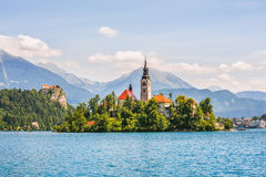 Catholic Church on Island and Bled Castle on Bled Lake Royalty Free Stock Images