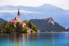 Catholic Church on Island and Bled Castle on Bled Lake Stock Photo
