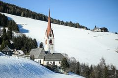 Catholic church in the Italian dolomites in wintertime with snow. stock image