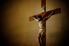 Catholic church and Jesus Christ on crucifix. Catholic church and crucifix of Jesus Christ Royalty Free Stock Photo